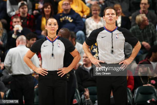 Referee officials Ashley MoyerGleich and Mark Ayotte look on during the game between the Indiana Pacers and Milwaukee Bucks on December 12 2018 at...