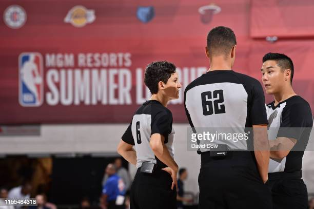 Referee officials Cheryl Flores Chance Moore and Evan Scott discuss a play during the game between the Sacramento Kings and LA Clippers during Day 7...