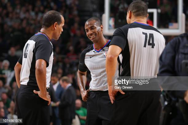Referee officials Eric Lewis John Butler and Curtis Blair discuss a play during the game between the New Orleans Pelicans and Milwaukee Bucks on...