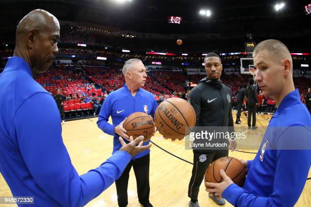 Referee officials Jason Phillips Tom Washington and Tyler Ford speak with Damian Lillard of the Portland Trail Blazers before the game against the...