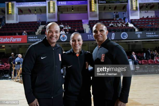 Referee officials Kevin Sparrock , Tiara Cruse, and Billy Smith pose for a photograh before the game between the Minnesota Lynx and New York Liberty...