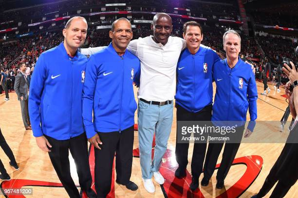 Referee officials Mike Callahan John Goble Mike Callahan Eric Lewis and Mark Ayotte pose with Vernon Maxwell before the game between the Houston...