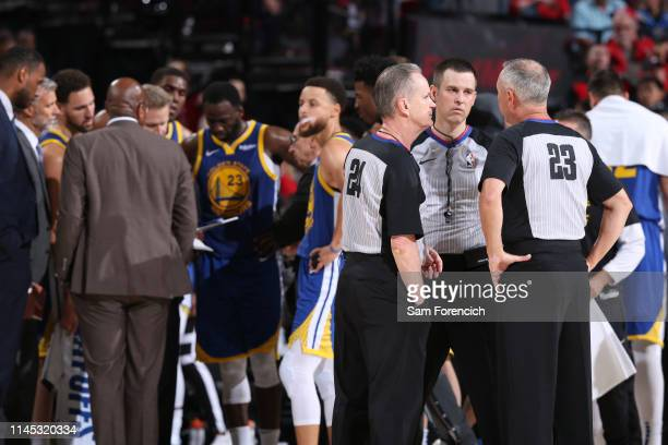 Referee officials Mike Callahan, Kevin Scott and Jason Phillips discuss a play during the game between the Golden State Warriors and Portland Trail...