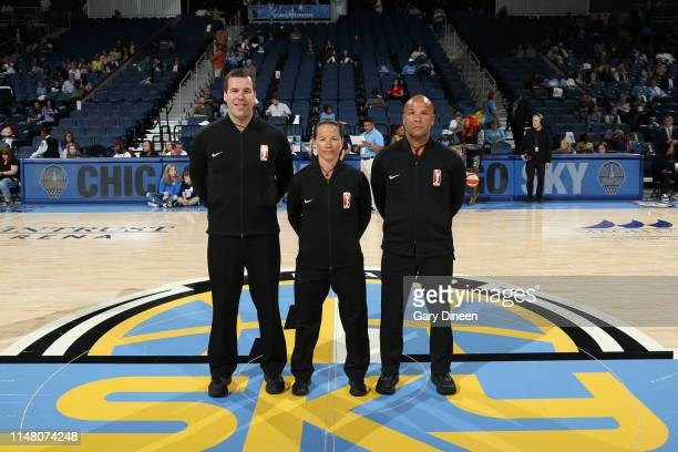 Referee officials Roy Gulbeyan Ashley Gilpin and Randy Richardson pose for a photograph before the game between the Chicago Sky and Seattle Storm on...