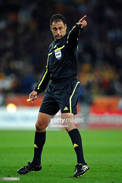 Referee Olegario Benquerenca officiates during the 2010 FIFA World Cup South Africa Quarter Final match between Uruguay and Ghana at the Soccer City...