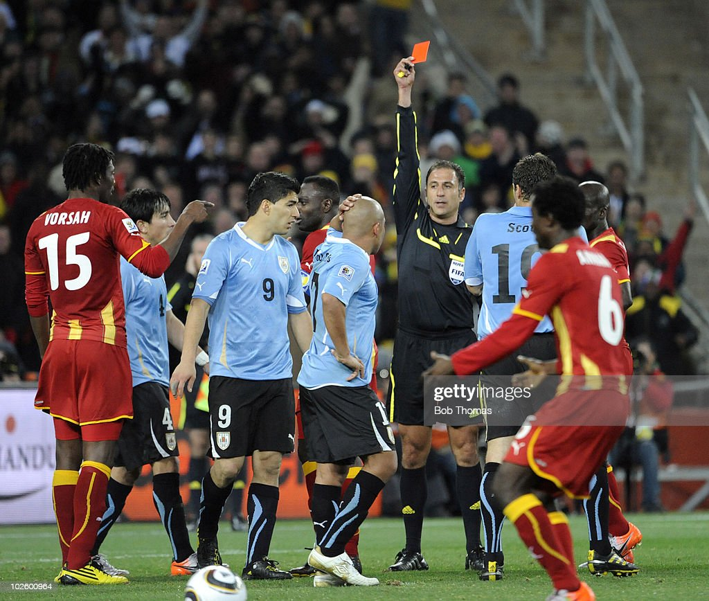Referee Olegario Benquerenca shows the red card and sends off Luis Suarez #9 of Uruguay after he handles the ball on the goal line during the 2010 FIFA World Cup South Africa Quarter Final match between Uruguay and Ghana at the Soccer City stadium on July 2, 2010 in Johannesburg, South Africa. The match ended 1-1 after extra-time. Uruguay won 4-2 on penalties.