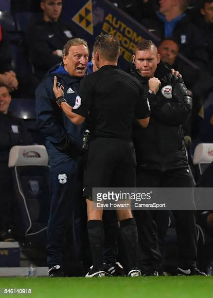 Referee Oliver Langford has words with Cardiff City's Manager Neil Warnock during the Sky Bet Championship match between Preston North End and...