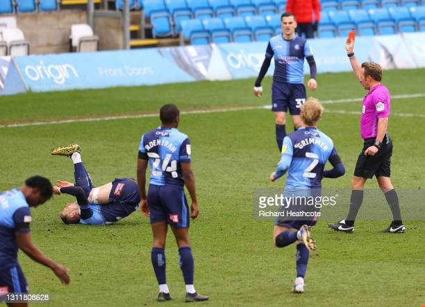 Referee Oliver Langford shows a red card to Josh Knight of Wycombe Wanderers during the Sky Bet Championship match between Wycombe Wanderers and...