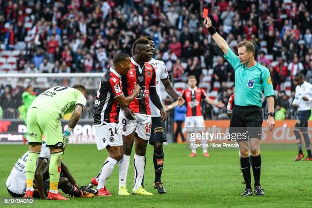 referee Olivier Thual gives a red card to Mario Balotelli of Nice during the Ligue 1 match between OGC Nice and Dijon FCO at Allianz Riviera on...