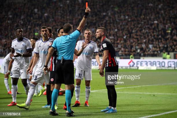 Referee Orel Grinfeld shows the red card to Ante Rebic of Frankfurt during the second leg of the UEFA Europa League playoff match between Eintracht...