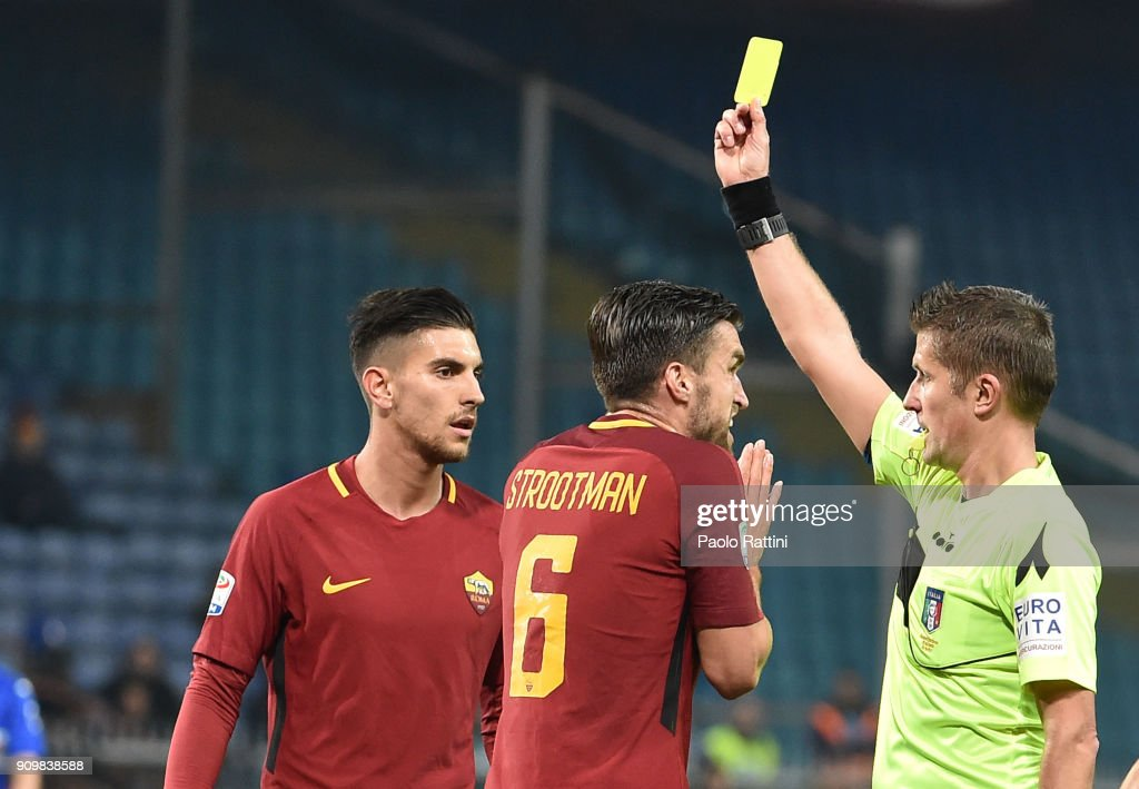 Referee Orsato shows the yellow card to Lorenzo Pellegrini of Roma during the Serie A match between UC Sampdoria and AS Roma on January 24, 2018 in Genoa, Italy.