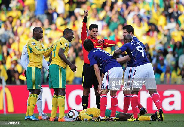 Referee Oscar Ruiz of Colombia sends off Yoann Gourcuff of France during the 2010 FIFA World Cup South Africa Group A match between France and South...