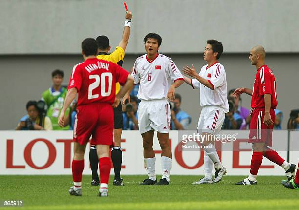 Referee Oscar Ruiz of Colombia shows the red card to Jiayi Shao of China during the second half during the Turkey v China Group C World Cup Group...