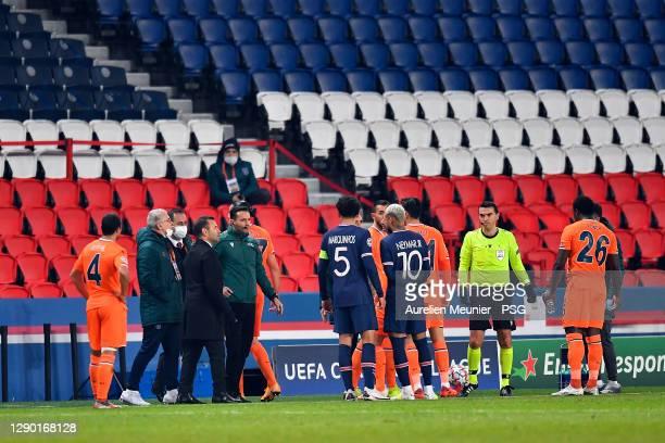 Referee Ovidiu Alin Hategan talks to Neymar Jr of Paris Saint-Germain reacts during the confusion following an alleged incident between Istanbul...