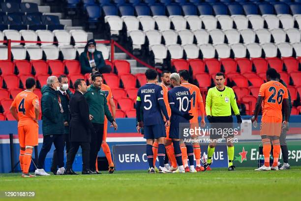 Referee Ovidiu Alin Hategan talks to Neymar Jr of Paris Saint-Germain reacts during the confusion following an alleged incident between Istanbul...