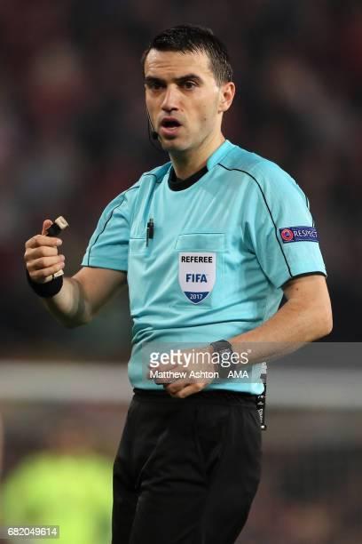 Referee Ovidiu Hategan looks on during the UEFA Europa League semi final second leg match between Manchester United and Celta Vigo at Old Trafford on...