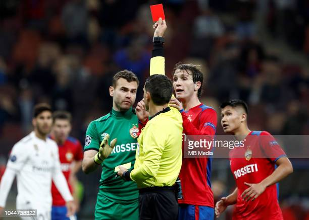 Referee Ovidiu Hategan shows red card to Igor Akinfeev of CSKA Moscow during the Group G match of the UEFA Champions League between CSKA Moscow and...
