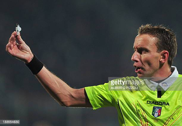 Referee Paolo Mazzoleni gestures during italian serie A football match Fiorentina vs Ac Milan on November 19, 2011 in Florence. AFP PHOTO / ALBERTO...