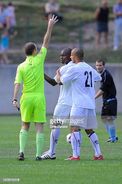 Referee Paolo Rosa issues a red card to Gaby Mudingayi of Bologna during a pre season friendly match between Bologna and Molveno on July 15 2010 in...