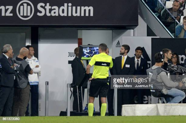 Referee Paolo Silvio Mazzoleni checks the VAR during the Serie A match between Juventus and SS Lazio on October 14 2017 in Turin Italy