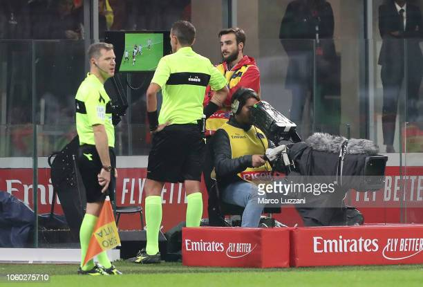 Referee Paolo Silvio Mazzoleni consult the VAR during the Serie A match between AC Milan and Juventus at Stadio Giuseppe Meazza on November 11 2018...
