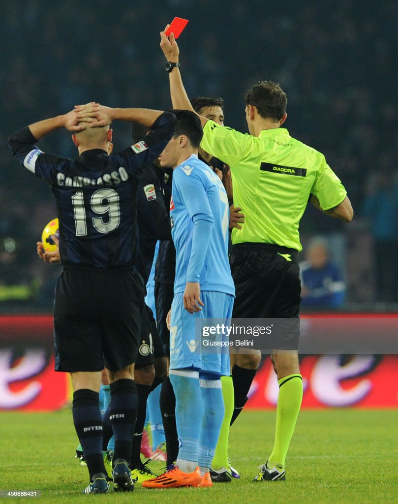 Referee Paolo Tagliavento shows a red card to Ricky Alvarez of FC Internazionale Milano during the Serie A match between SSC Napoli vs FC Internazionale Milano at Stadio San Paolo on December 15, 2013 in Naples, Italy.