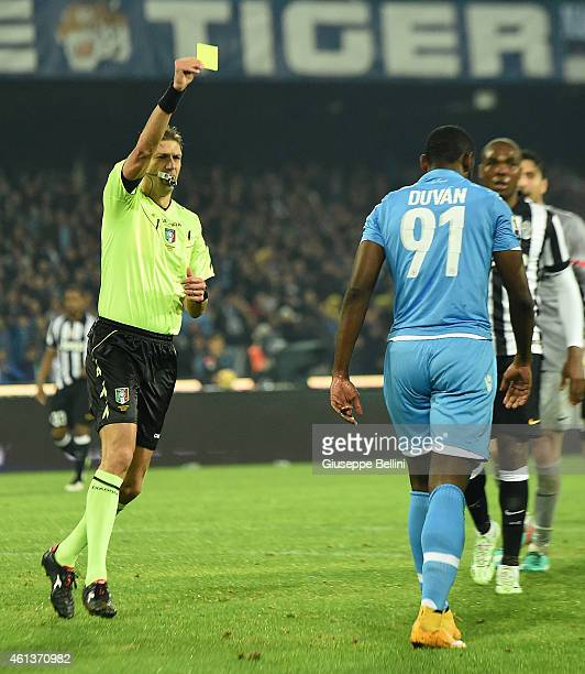 Referee Paolo Tagliavento shows the yellow card to Duvan Zapata of Napoli during the Serie A match between SSC Napoli and Juventus FC at Stadio San...