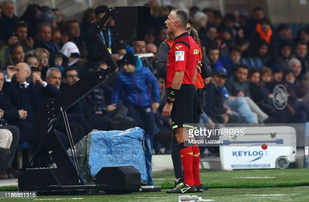 Referee Paolo Valeri consults the VAR during the Serie A match between Atalanta BC and Hellas Verona at Gewiss Stadium on December 7 2019 in Bergamo...