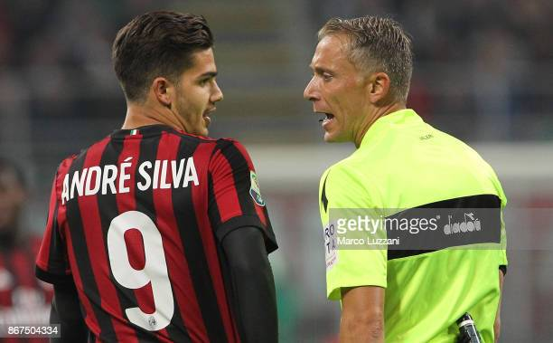 Referee Paolo Valeri disputes with Andre Silva of AC Milan during the Serie A match between AC Milan and Juventus at Stadio Giuseppe Meazza on...