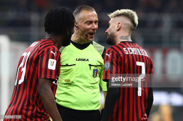 Referee Paolo Valeri disputes with Samuel Castillejo of AC Milan during the Coppa Italia Semi Final match between AC Milan and Juventus at Stadio...