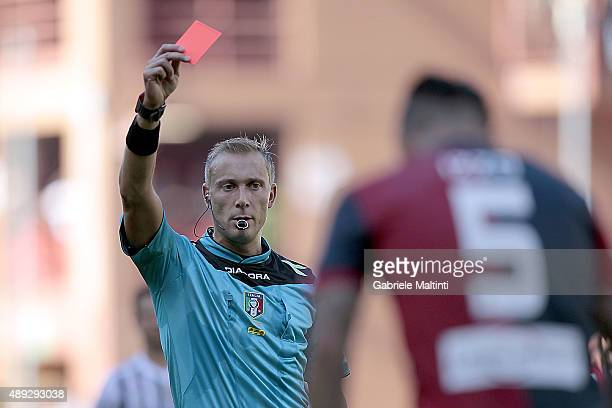 Referee Paolo Valeri shows the red card to Armando Izzo of Genoa CFC during the Serie A match between Genoa CFC and Juventus FC at Stadio Luigi...