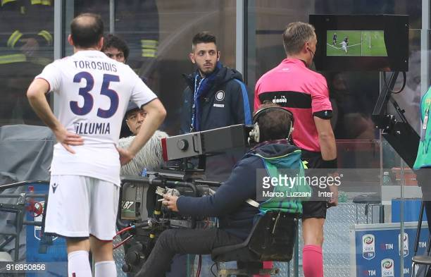 Referee Paolo Valeri watches the VAR screen during the serie A match between FC Internazionale and Bologna FC at Stadio Giuseppe Meazza on February...