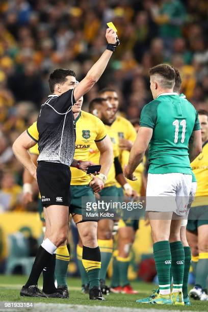 Referee Pascal Gauzere shows Jacob Stockdale of Ireland a yellow card during the Third International Test match between the Australian Wallabies and...