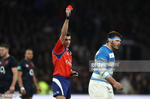 Referee Pascal Gauzere shows the red card to Enrique Pieretto during the Old Mutual Wealth Series match between England and Argentina at Twickenham...