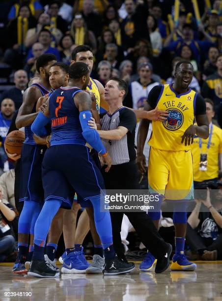 Referee Pat Fraher separates Carmelo Anthony of the Oklahoma City Thunder from Draymond Green of the Golden State Warriors at ORACLE Arena on...