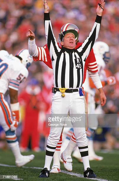 Referee Pat Haggerty signals a touchdown for San Francisco 49ers as quarterback Joe Montana connects with wide receiver Carl Monroe for a TD in the...