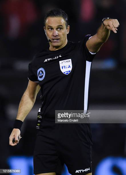 Referee Patricio Lousteau gestures during a match between Huracan and River Plate as part of Superliga Argentina 2018/19 at Estadio Tomas Adolfo Duco...