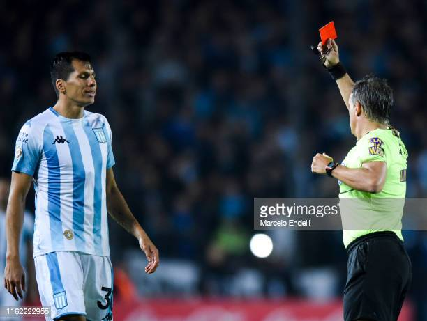 Referee Patricio Lousteau shows red card to Leonardo Sigali of Racing Club during a match between Racing Club and River Plate as part of Superliga...