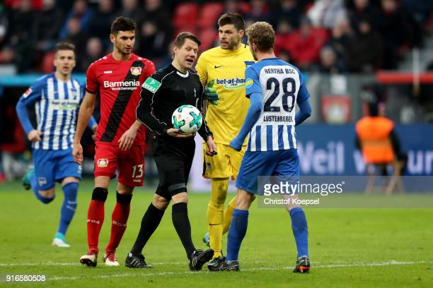Referee Patrick Ittrich decide for a freekick in the 16years center and talks too Rune Jarstein and Fabian Lustenberger of Berlin during the...