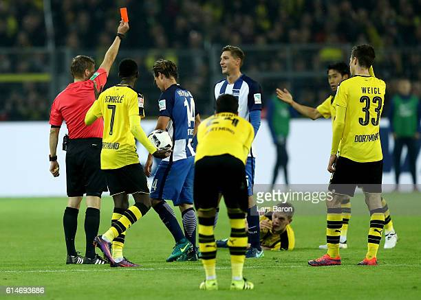 Referee Patrick Ittrich shows Valentin Stocker of Berlin the red card during the Bundesliga match between Borussia Dortmund and Hertha BSC at Signal...