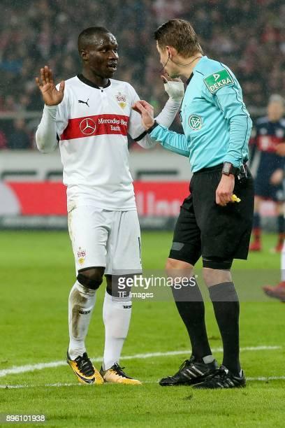 Referee Patrick Ittrich speak with Chadrac Akolo of Stuttgart during the Bundesliga match between VfB Stuttgart and FC Bayern Muenchen at...