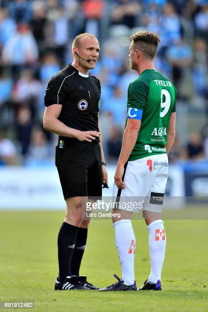 Referee Patrik Eriksson and Tommy Thelin of Jonkopings Sodra during the Allsvenskan match between Jonkopings Sodra IF and Malmo FF at...