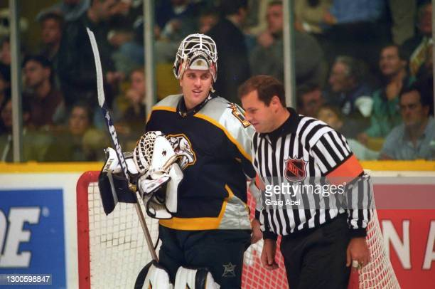 Referee Paul Devorski has a chat with Mike Dunham of the Nashville Predators against the Toronto Maple Leafs during NHL game action on October 19,...