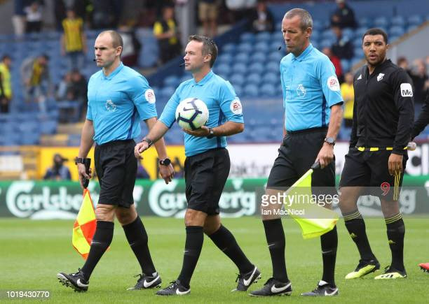 Referee Paul Tierney and assistant referee's Adrian Holmes and Michael McDonough are seen prior to the Premier League match between Burnley FC and...