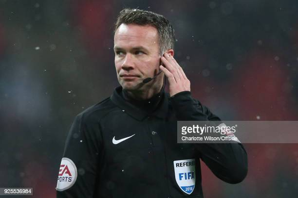 Referee Paul Tierney awaits a VAR decision during the Emirates FA Cup Fifth Round Replay match between Tottenham Hotspur and Rochdale at Wembley...