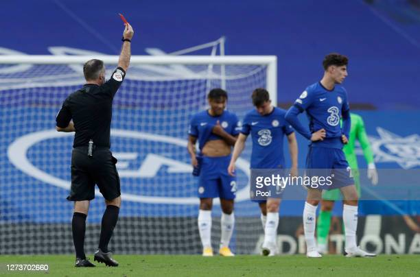 Referee Paul Tierney awards Andreas Christensen of Chelsea a red card, following a VAR review, overriding his original decision of a yellow card...