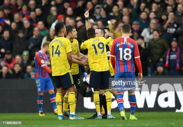 Referee Paul Tierney awards Pierre-Emerick Aubameyang of Arsenal a red card following a VAR review during the Premier League match between Crystal...