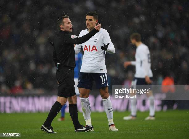 Referee Paul Tierney consults VAR and dissalows a goal as Erik Lamela of Tottenham Hotspur questions during the Emirates FA Cup Fifth Round Replay...