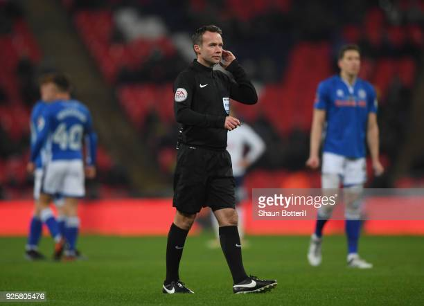 Referee Paul Tierney consults VAR and dissalows a goal during the Emirates FA Cup Fifth Round Replay match between Tottenham Hotspur and Rochdale on...