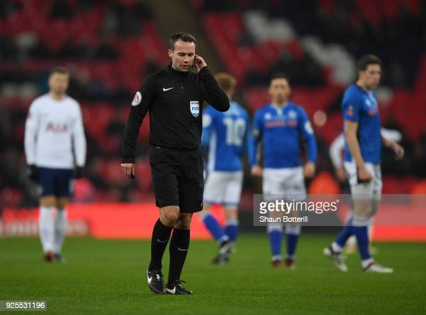 Referee Paul Tierney consults VAR and dissalows a goal from Eric Lamela of Tottenham Hotspur during the Emirates FA Cup Fifth Round Replay match...